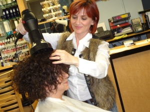 Once it's put in, Ana or one of our additional hair specialists, will style it for you.